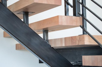 maple and steel suspended staircase closeup