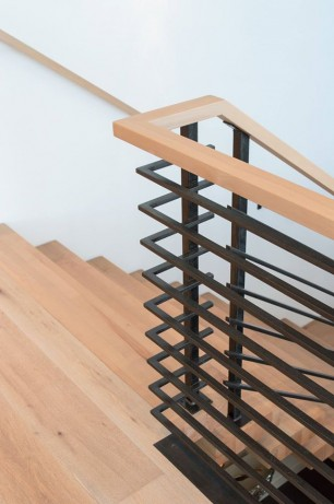 maple and steel suspended staircase handrail